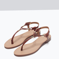 Flat sandals with gold-tone detail