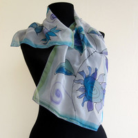 "Hand Painted Shawl  "" Blue Flowers "" with floral design . 100 % natural silk scarf , paint by hand in blue colors ."