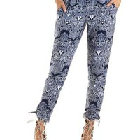 Paisley Ankle Tie Jogger Pants by Charlotte Russe