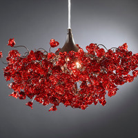 Red roses. Chandeliers.