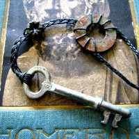 Key necklace with rusty metal washer and screw nut on handbraided black cord