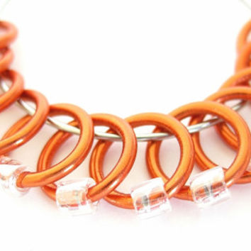 Medium snagless ring stitch markers for knitting   snag-free stitchmarkers   knitting stitchmarkers   orange rings; clear beads   #0045