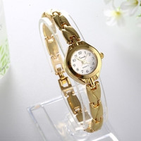 Hot sale Women royal gold Dial watch for women carve stainless steel Bracelet Watch Time Quartz women dress watches (Color: Gold) = 1956347076