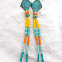 Long Seed beaded knotted green patina earrings.