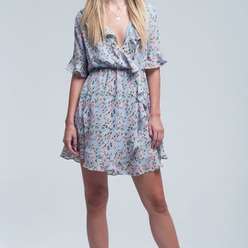 Floral dress in blue with ruffle detail