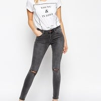 ASOS   ASOS Lisbon Skinny Mid Rise Jeans in Slick Gray Wash with Ripped Knees at ASOS