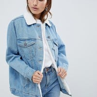 ASOS DESIGN Petite denim jacket with fleece collar in midwash blue at asos.com