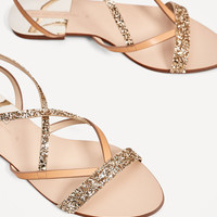 FLAT SANDALS WITH SHINY STRAPS DETAILS