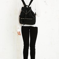 PU Zip Flap Backpack in Black at Urban Outfitters