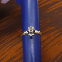 A tiny silver plated skull with crystal mult-task ring, above knuckle ring,stackable ring, toe ring, little finger ring