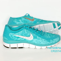 Just released! Women's Nike Free 5.0 v4 in Bleached Turquoise/Metallic Silver with 5 sizes of Crystal Clear Swraovki crystals