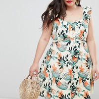 ASOS DESIGN Curve frill sleeve button front sundress in tropical print at asos.com