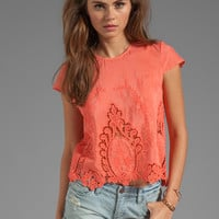 Dolce Vita Story Petticoat Embroider Blouse in Melon from REVOLVEclothing.com