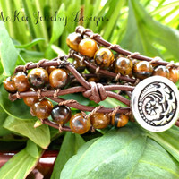 Tigers eye stone and leather wrap bracelet with silver flower button clasp.