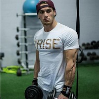 New Workout Clothes Cotton RISE  Gyms T Shirts  Mens Short Sleeve T-shirt Muscle Gyms Fitness Clothing Bodybuilding Tops