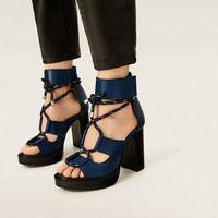 LEATHER SANDALS WITH TRACK SOLE