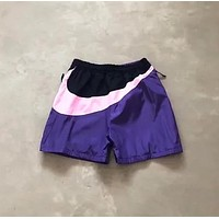 NIKE Fashion New front embroidery letter behind big hook woemn and men shorts Purple