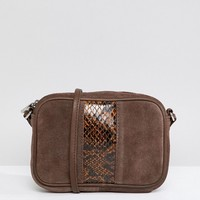 ASOS DESIGN suede and snake mix camera cross body bag at asos.com