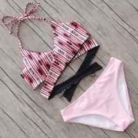 Upper red print halter back knot bottom pink two piece bikini