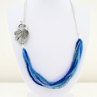 Blue bead and chain necklace, ocean colours seed beads, side fastening with leaf t-bar necklace.