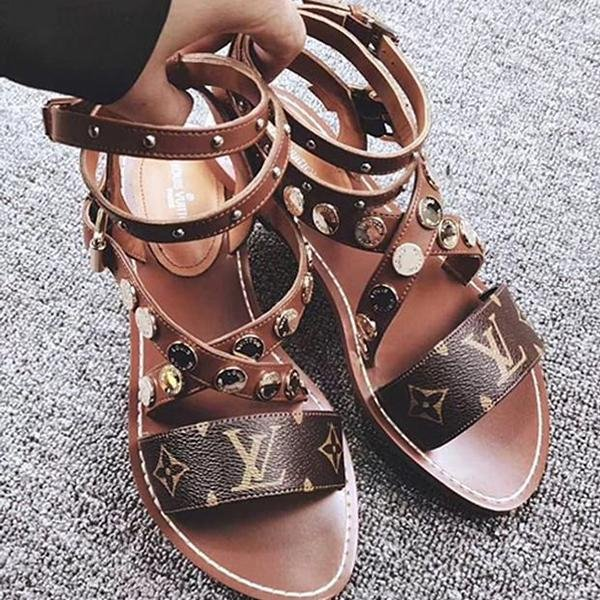 Image of Louis Vuitton LV Buttoned flat-soled sandals