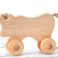 Wooden cow with wheels