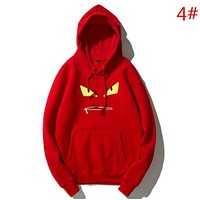 Fendi Fashion New Autumn And Winter Bust Eye Mouth Print Couple Keep Warm Hooded Long Sleeve Sweater Top Red