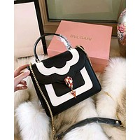 BVLGARI 2018 new snake head color matching wild portable small square bag shoulder Messenger bag black