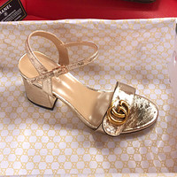 GUCCI Large pair of G THICK HEEL SANDALS