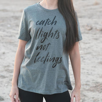 Catch Flights Not Feelings Shirt. Funny Graphic Shirt. Triblend Basic Workout Shirt. Girls Weekend. Girls Trip. Single AF. Vacation. Vacay