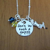 """Little Mermaid Inspired Necklace. Flounder fish necklace. """"Don't be such a guppy"""". Silver colored, Hand Stamped, Swarovski Elements."""