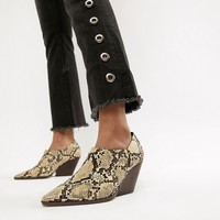 Mango stacked heel ankle boot in snake effect at asos.com