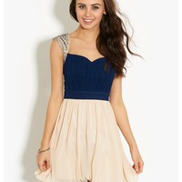 Little Mistress 2in1 Embellished Prom Dress in navy rouched bodice, cream chiffon skirt and embellished detailing on the shoulders