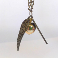 """Harry Potter book/movie series antique gold and brass tones necklace """"Golden Snitch"""" from the game Quidditch -Bronze Tone Golden Snitch Harry Potter The Deathly Hallows"""