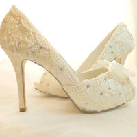 Lacey Ivory with Swarovski crystal and faux pearl adornments.  bespoke wedding shoes