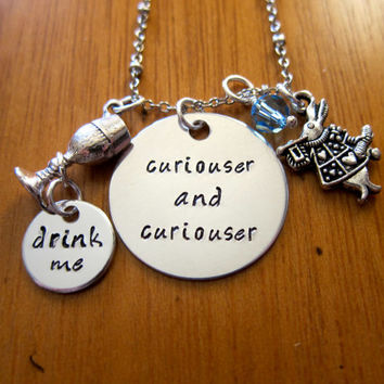 """Disney's """"Alice in Wonderland"""" Inspired Necklace. """"Curiouser and curiouser"""". Drink me. Silver colored. Swarovski crystals."""