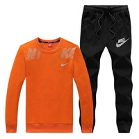 NIKE New fashion letter hook print couple leisure long sleeve top and pants two piece suit Orange