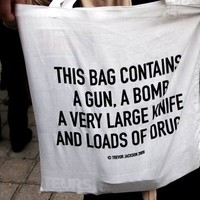 This Bag Contains a Gun, A Bomb, A Very Large Knife and Loads of Drugs.