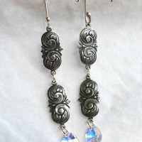 Swarovski clear crystal and silver engraved dangle earrings.