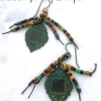 Seed beaded knotted green patina earrings.