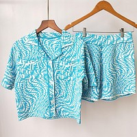FENDI summer new irregular FF letter jacquard knitted cardigan top and shorts two-piece set