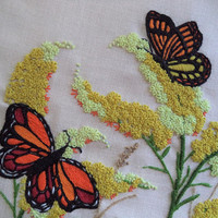 Large monarch butterfly embroidery/ vintage butterfly and milkweed embroidered fabric/ orange yellow red butterflies and flowers