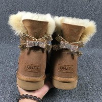2017 high quality new type of bow tied snow boots, 100% natural Australian sheep skin, one female boots free delivery