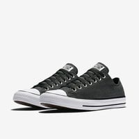The Converse Chuck Taylor All Star Washed Chambray Low Top Unisex Shoe.