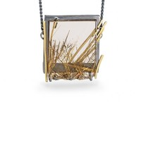 Beautiful one-off rutilated quartz pendant with 18ct yellow gold on an oxidised silver chain.