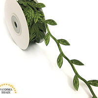 Leaf ribbon, garland with leaves in moss green with satin effect. Delicate trim at wholesale price. Spool with 10 yards