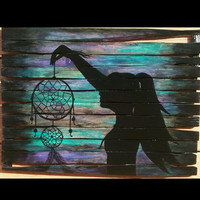Girl holding dream catcher, pallet painting, silhouette paintings, #wood wall decor, #mothers day gifts, dream catcher art, painted pallet