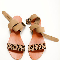 Summer shoes. leopard and Beagie Ssandals. An open beige and leopard pattern, leather bands, flat sandal.
