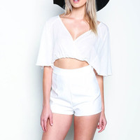 WHITE CUT OUT WRAP BELL ROMPER