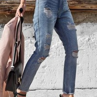 In the Works Light Wash High-Waisted Distressed Jeans